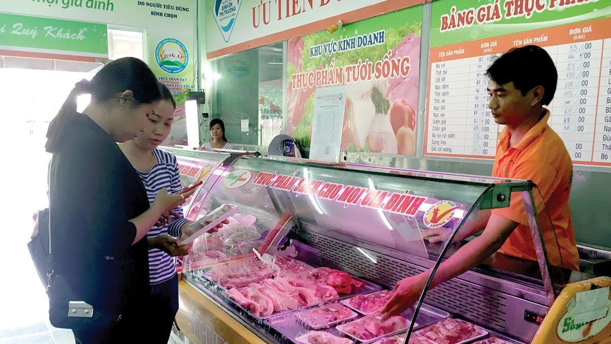 Điều chỉnh giá thịt heo bình ổn giảm 3,6%-8,9% ảnh 1