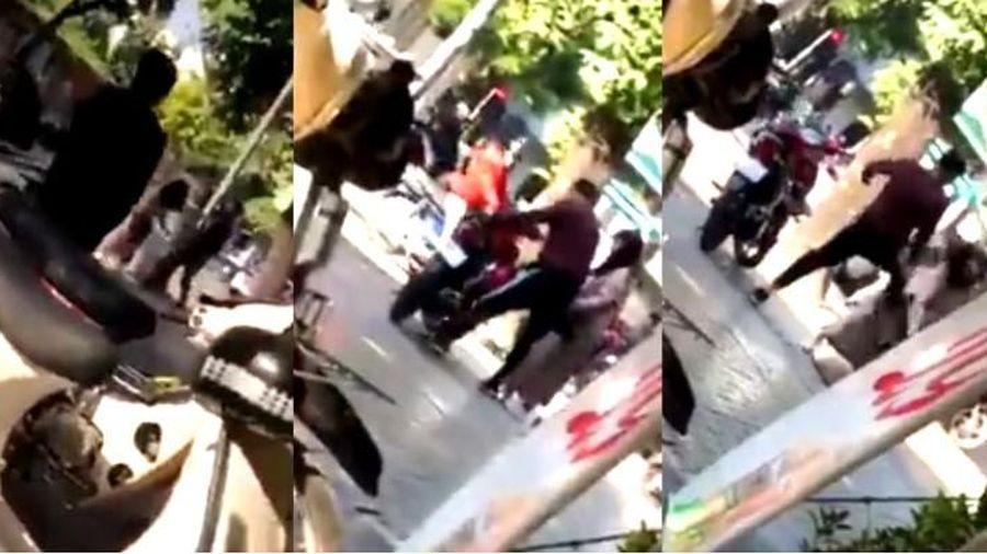 Bị đá tới tấp vì văng tục, cô gái cầm mũ bảo hiểm phang bạn trai trên phố Hà Nội