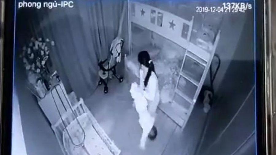 Tạm giữ hình sự người giúp việc xách ngược chân và lắc bé gái 14 tháng tuổi
