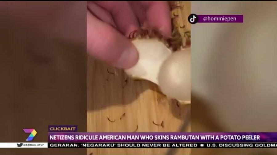 Ông Tây loay hoay dùng dao và nạo để ăn... quả chôm chôm