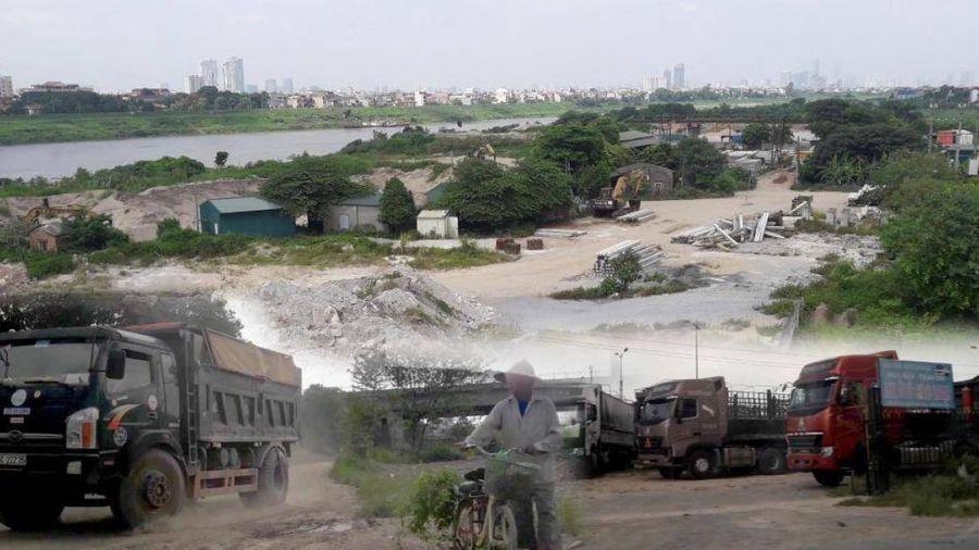 Chính quyền nói gì về bãi tập kết vật liệu trái phép ở chân cầu Đông Trù?