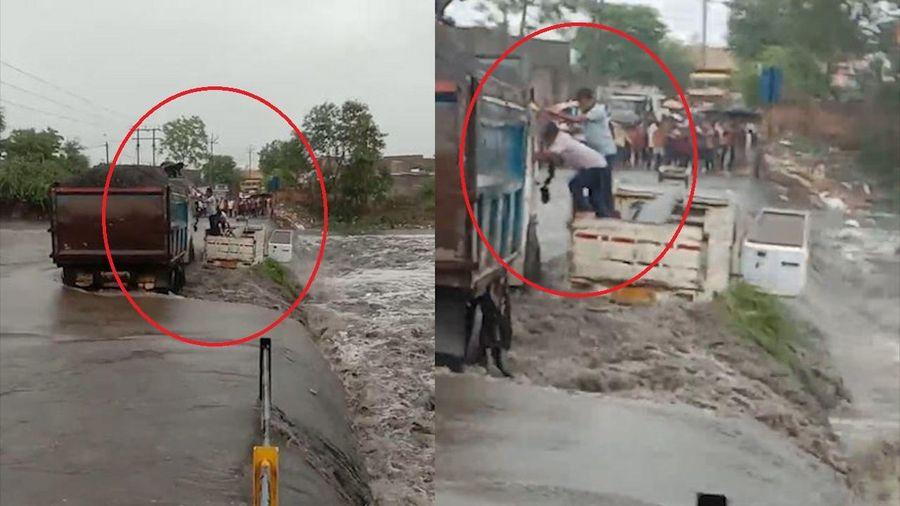Mưa lũ cuốn xe tải kéo theo 3 người rơi xuống nước
