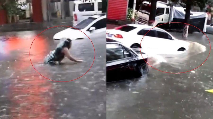 Người phụ nữ bơi trên đường bị ngập suýt bị ôtô đâm trúng