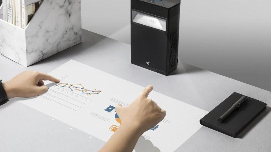 Máy chiếu biến mọi bề mặt bạn chạm vào thành màn hình cảm ứng