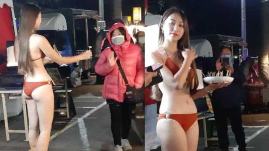 Diện bikini để bán ổi bất chấp lạnh 9 độ C, cô gái xinh đẹp khiến dân tình 'tròn mắt'