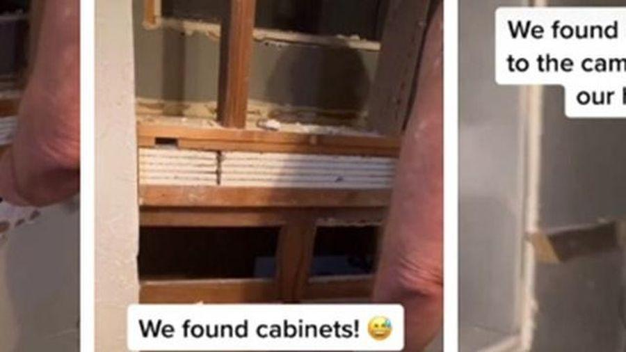 Phát hiện bí mật sởn da gà sau chiếc gương bị gắn chặt bất thường trong nhà mới