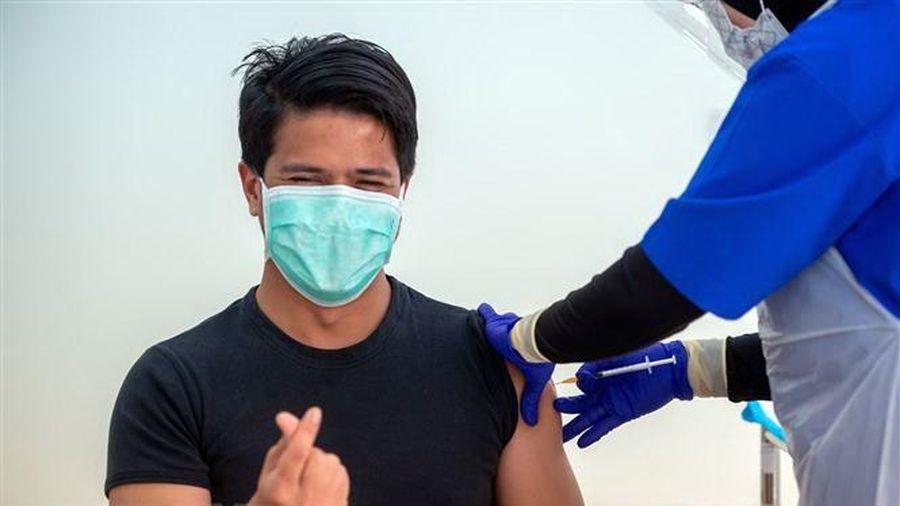 COVID-19: Malaysia cấp giấy chứng nhận tiêm chủng thông minh