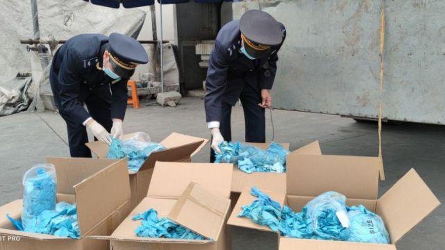 Khởi tố tội buôn hàng cấm với DN bán găng tay đã qua sử dụng