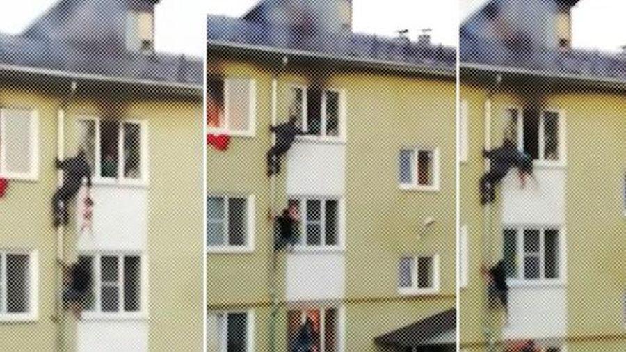 3 đứa trẻ mắc kẹt trong căn hộ bốc cháy ngùn ngụt, hàng xóm không đợi cứu hỏa đến mà 'tự xử' tạo ra cảnh tượng thót tim